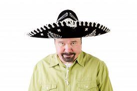 grumpy_middle_aged_man_in_mexico_sombrero_hat_cg1p61719280c_th